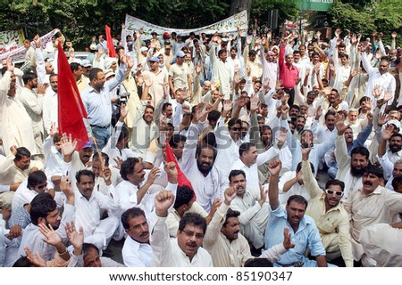 LAHORE, PAKISTAN - SEPT 22: Protesters chant slogans in favor of their demands during a protest demonstration arranged by WAPDA Hydro Electric Central Labor Union on September 22, 2011 in Lahore. - stock photo