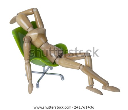Laid back in a green chair for comfort - path included - stock photo