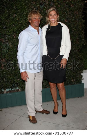 Laird Hamilton and Gabrielle Reece at a Benefit Dinner For The Natural Resources Defense Council's Ocean Initiative hosted by Chanel, Privaye Location, Malibu, CA. 06-04-11 - stock photo