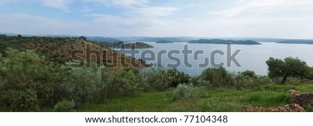 Lake among Mediterranean hills - stock photo