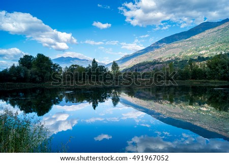 Lake and mountain with reflection in a sunny day