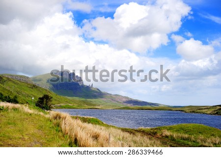 Lake and Mountains in Isle of Skye island under a cloudy sky. Landscape in Highlands of Scotland, Uk, Europe. - stock photo