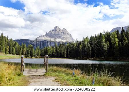 Lake Antorno and the south face of Tre Cime of Lavaredo, Dolomites, Italy - stock photo