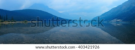 Lake at dusk with reflections and mountains in Banff National Park, Canada. - stock photo