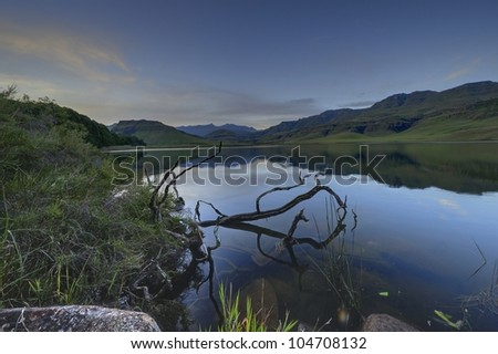 Lake at Giants Cup Wilderness Reserve. View of the Ukhalhamba Drakensberg world heritage park, Kwazulu Natal, South Africa - stock photo