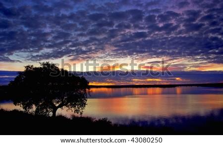 Lake at sunset, Portugal. - stock photo