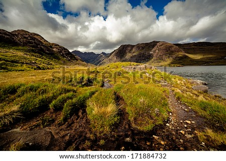 Lake at the foot of the Black Cuilin, Isle of Skye, Scotland - stock photo