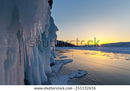Lake Baikal in winter. Cold sunset in February - stock photo