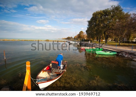 LAKE BALATON, HUNGARY - OCT 20: Senior citizen in a boat on October 20, 2013 on Lake Balaton, Hungary. It is largest lake in central Europe