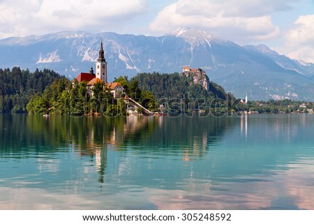 Lake Bled and island surrounded by mountains and forests, Slovenia. - stock photo