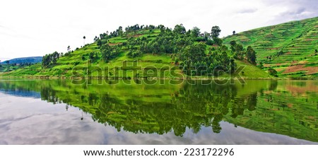 Lake Bunyonyi in Uganda, Africa, at the borders of Uganda, Congo Democratic Republic and Rwanda, not far from the Bwindi National Park, home of the last mountain gorillas - stock photo