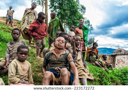 LAKE BUNYONYI, UGANDA - OCTOBER 21: Batwa pigmy boys on October 21, 2012 at Lake Bunyonyi, Uganda. Pigmy people are ancient dwellers in the forests, they were known as 'The Keepers of the Forest' - stock photo