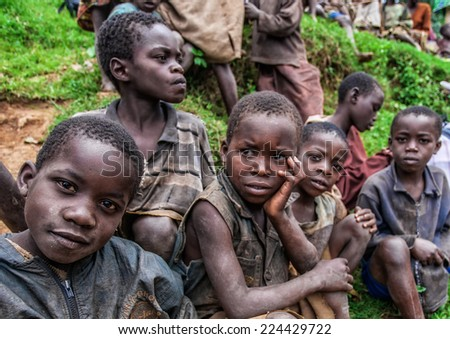 LAKE BUNYONYI, UGANDA - OCTOBER 21: Unidentified Batwa pigmy boys on October 21, 2012 at Lake Bunyonyi, Uganda. Pigmy people are ancient dwellers in the forests, they were known as 'The Keepers of the Forest' - stock photo