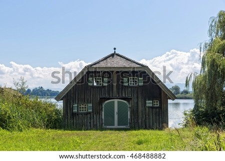Lake Chiemsee, Bavaria, Germany - August 7th, 2016. Typical and beautiful boathouse near Rimsting.