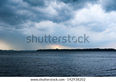 lake chiemsee with heavy weather rain clouds - stock photo