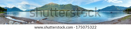 Lake Como (Italy) summer cloudy evening panorama with stony shore