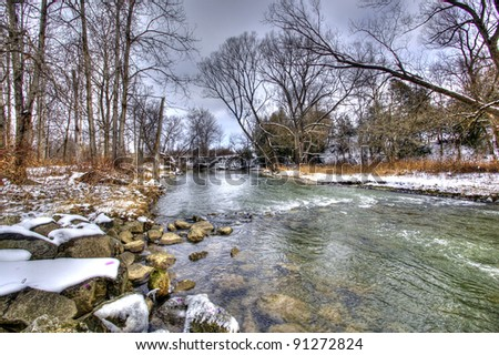 lake covered by ice and snow - stock photo