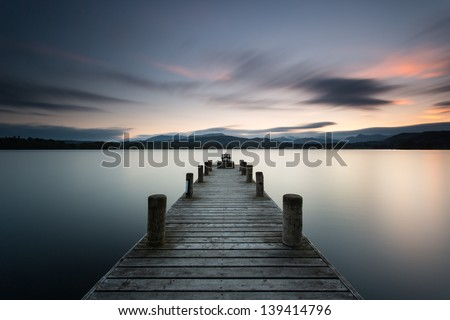 Lake District, Low Wood jetty near Ambleside at dusk - stock photo
