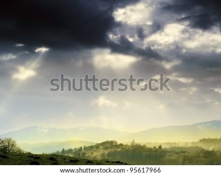 lake district national park cumbria england uk - cloudburst and sunburst, sunset over far sawrey - stock photo