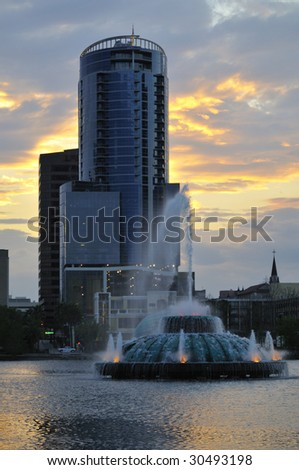 Lake Eola Fountain in downtown Orlando, FL with high-rise building in distance