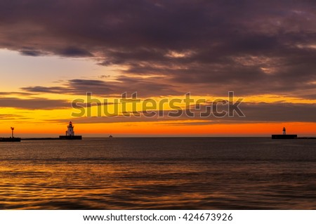 Lake Erie beacons at the harbor entrance of Cleveland Ohio after sunset - stock photo