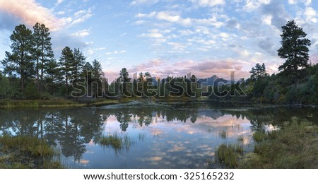 Lake forest at sunset - stock photo