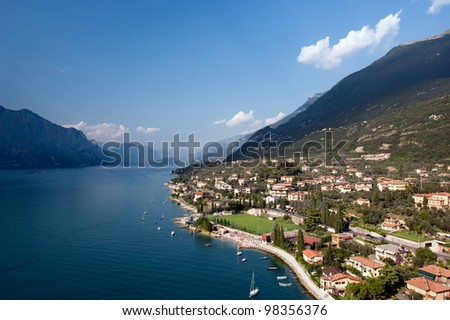 Lake Garda is the largest lake in Italy. It is located in Northern Italy, about half-way between Brescia and Verona, and between Venice and Milan. - stock photo