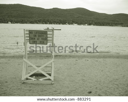 Lake George-lifeguard chair and sign