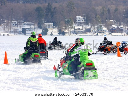 LAKE GEORGE, NY - February 7, 2009: A group of snowmobiles leaving after a fun filled day at the February 7 , 2009 Lake George Winter Carnival