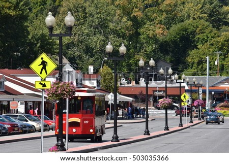 LAKE GEORGE, NY - SEP 24: Trolley in Lake George Village, in New York State, as seen on Sep 24, 2016. The lake lies within the upper region of the Great Appalachian Valley.