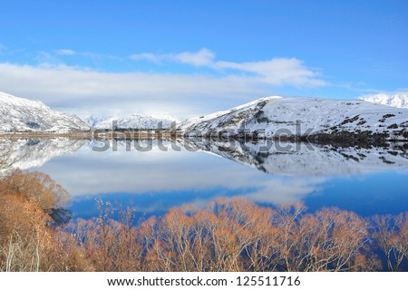 Lake Hayes with snow mountain reflections - stock photo