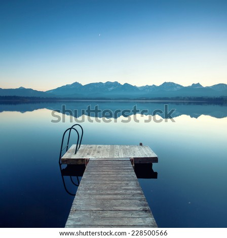 Lake Hopfensee, a mountain lake near Fuessen, Germany at sunset.  - stock photo