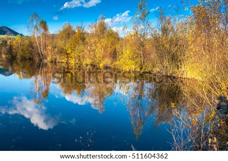 Lake in autumn colours of nature