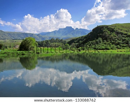 Lake in front of Cathkin peak. Shot in Monks Cowl area, Drakensberg Mountains, South Africa. - stock photo