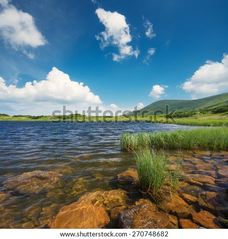 Lake in mountain valley. Beautiful natural landscape - stock photo