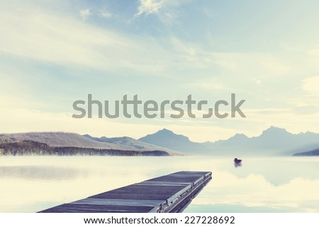 Lake in Rocky mountains - stock photo