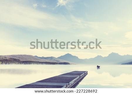 Lake in Rocky mountains - stock photo