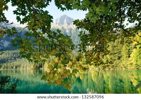 Lake in the Alpine mountains, Italy - stock photo