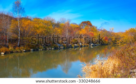 Lake in the autumn evening