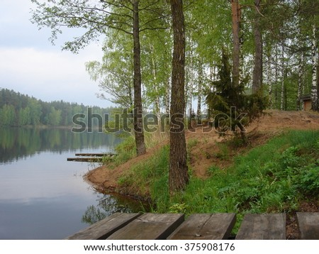 Lake in the middle of forests in summer season in countryside - stock photo