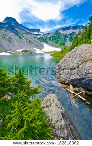 Lake in the mountains. Gorgeous view, outlook, panorama at the Mount Baker lands and wilderness and rocky grounds. North America. - stock photo