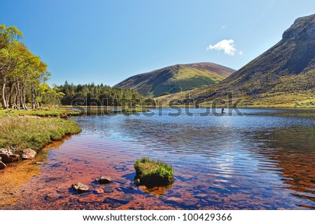 Lake in the mountains of the Dingle Peninsula in Ireland. - stock photo