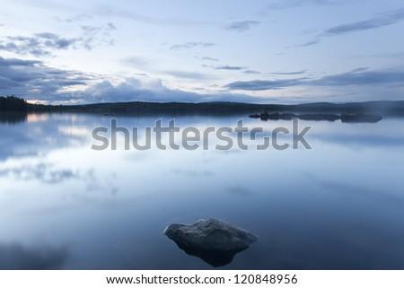 Lake in twilight, Sweden - stock photo