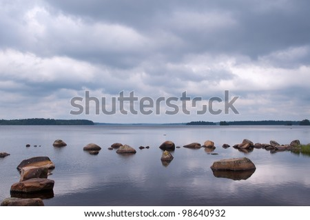 Lake Innaren in South Sweden with dramatic clouds on a summer day  - stock photo