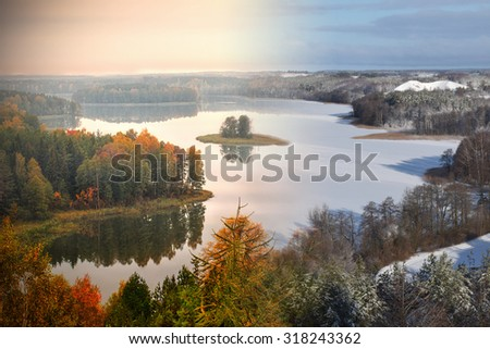 Lake Jedzelwo in autumn  and winter. Composition fifty fifty. Masuria, Stare Juchy, Poland. - stock photo