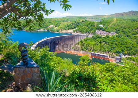 Lake Kariba dam wall and a statue of nyami nyami the river snake god.  Zambezi river.  Zimbabwe Africa. - stock photo