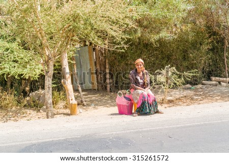 Lake Koka, Ethiopia - February 20, 2015: Picture of young girl waiting on the road. Picture was taken when riding on the road by Lake Koka in Ethiopia.