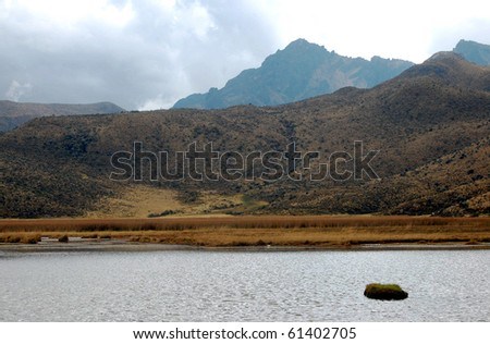 Lake Limpiopungo, with the Ruminahui mountain in the background, on a cloudy day. The Andes, Ecuador, South America. - stock photo