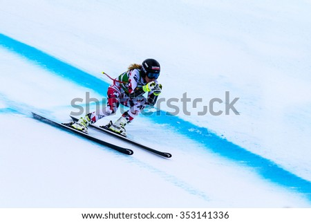LAKE LOUISE, ALBERTA CANADA - DEC.7.2015. : 56 official entry speeds down the course during the Audi FIS Alpine Ski World Cup Ladies Super G race. The average speed is 110 km/h during the race.  - stock photo
