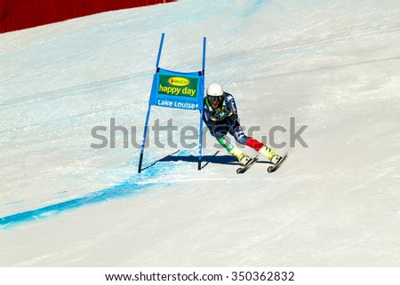 LAKE LOUISE, ALBERTA CANADA - OCT.29.2015. : 64 official entry speeds down the course during the Audi FIS Alpine Ski World Cup Men's race. The average speed is 132 km/h during the race.  - stock photo